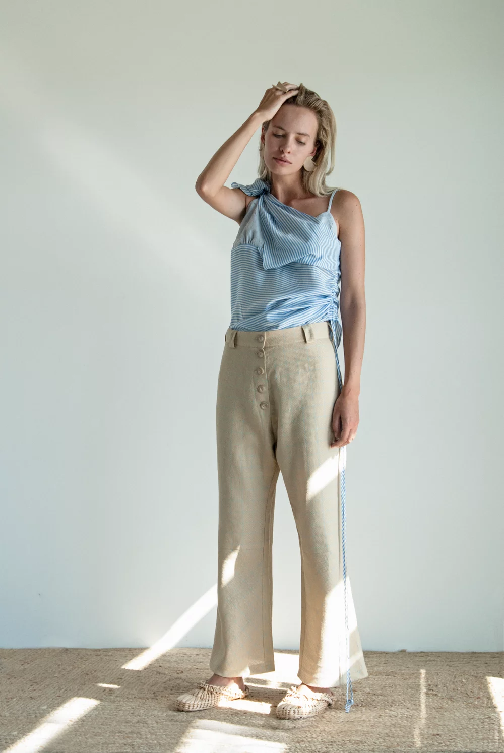 "389e383557061 ""A closer look at these linen trousers reveals an extra-special detail: a  barely-there checkered pattern in the lightest blue."""